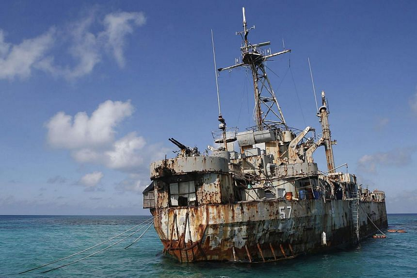 The BRP Sierra Madre, a marooned transport ship which Philippine Marines live on as a military outpost, is pictured in the disputed Second Thomas Shoal, part of the Spratly Islands in the South China Sea on March 30, 2014. -- FILE PHOTO: REUTERS