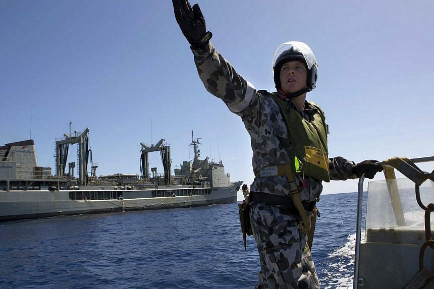 A Rigid Hull Inflatable Boat deployed from the Australian Navy ship the HMAS Success searches for the missing Malaysian Airlines flight MH370 on April 2, 2014.-- PHOTO: REUTERS