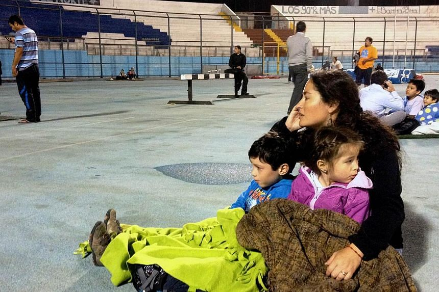 People taking refuge in a stadium after a powerful 8.2-magnitude earthquake hit off Chile's Pacific coast, in Iquique on April 1, 2014. -- PHOTO: AFP