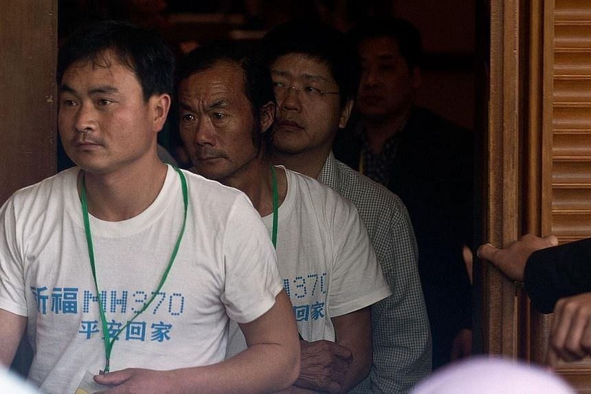 Chinese relatives of passengers aboard the missing Malaysia Airlines flight MH370 leaving after a briefing by the Malaysian Department of Civil Aviation at a hotel in Bangi on April 2, 2014. -- PHOTO: AFP