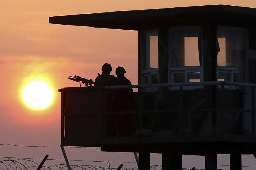 South Korean marines stand guard at a guard post on Baengnyeongdo, an island near the border with North Korea, on April 2, 2014. -- PHOTO: REUTERS