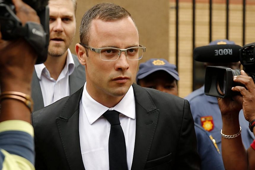 Oscar Pistorius leaves the court after his trial for the murder of his girlfriend, Reeva Steenkamp, was postponed at the North Gauteng High Court in Pretoria on March 28, 2014. -- FILE PHOTO: REUTERS
