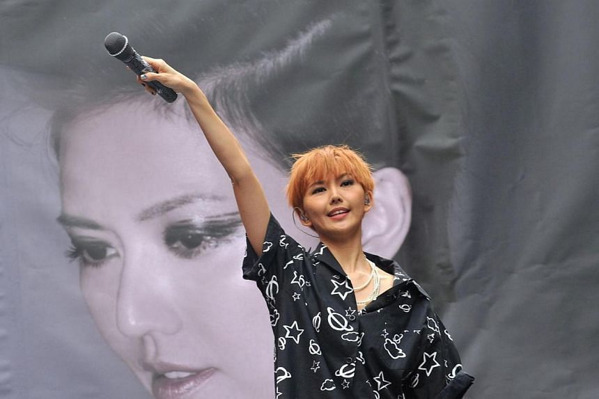 """Singapore pop singer Stefanie Sun performs during a promotional signing event for her new album """"Kepler"""" in Taipei on March 1, 2014.Homegrown Mandopop queen Stefanie Sun might not have kicked off her comeback tour in Singapore but it will still"""