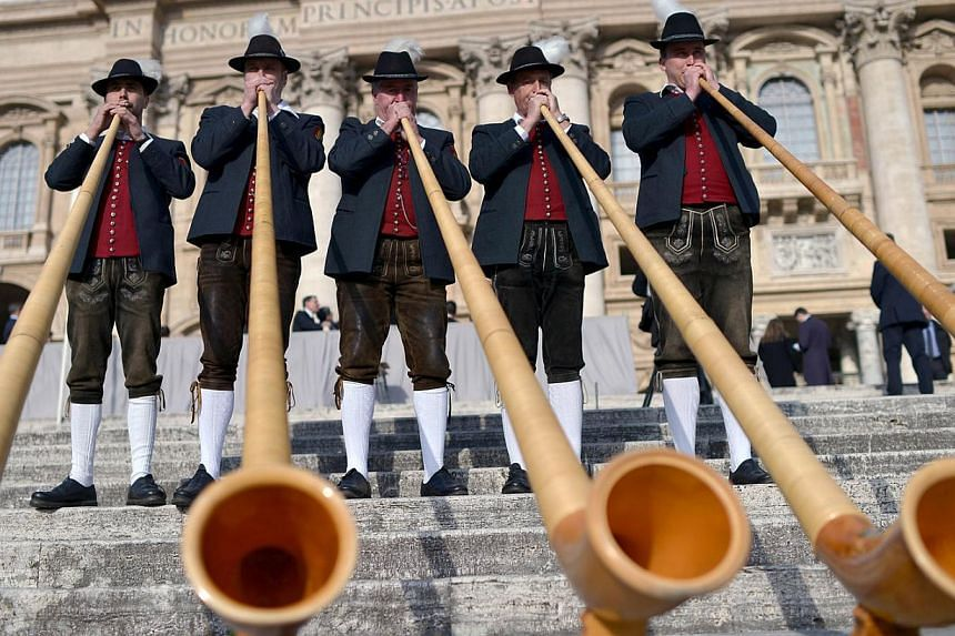 Bavarian musicians from Engetried play traditional horns in St. Peter's square prior to the pope's weekly general audience on April 2, 2014 at the Vatican. -- PHOTO: AFP