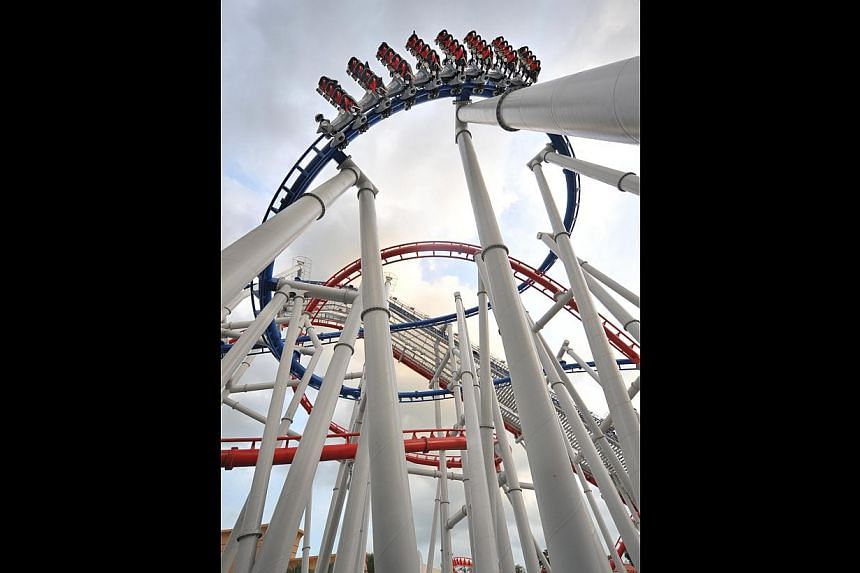 The Battlestar Galactica ride boasts the world's tallest pair of duelling roller coasters and can go as fast as 90kmh. -- ST FILE PHOTO