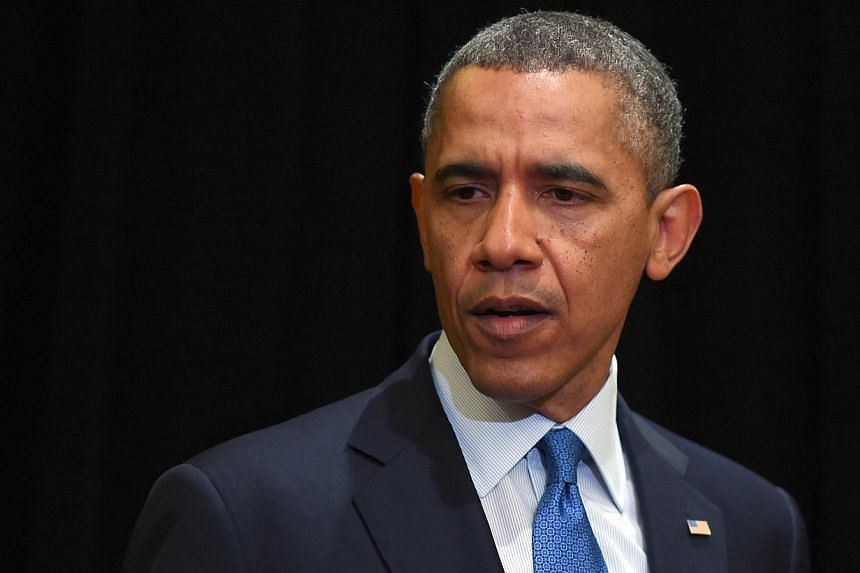 """""""We are going to get to the bottom of exactly what happened,"""" Mr Obama told reporters in Chicago, where he is traveling for Democratic fundraisers. -- PHOTO: AFP"""