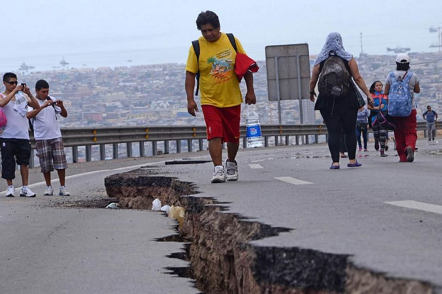 A cracked road in Iquique, northern Chile, on April 2, 2014, a day after a powerful 8.2-magnitude earthquake hit off Chile's Pacific coast. -- PHOTO: AFP