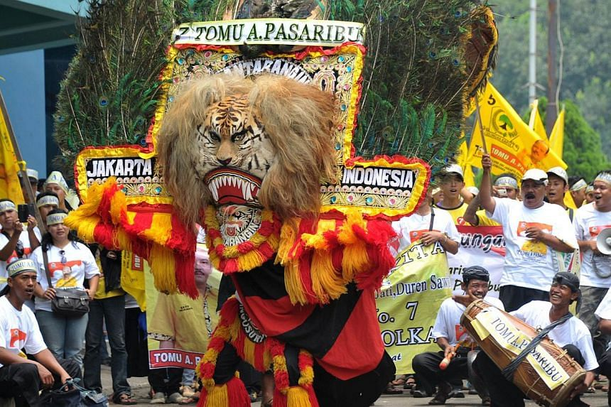 Supporters of the Golkar party perform traditional Reog dance during a campaign rally ahead of legislative elections in Jakarta on April 3, 2014. Indonesia, the world's biggest Muslim-majority nation with 250 million people, will hold legislative pol