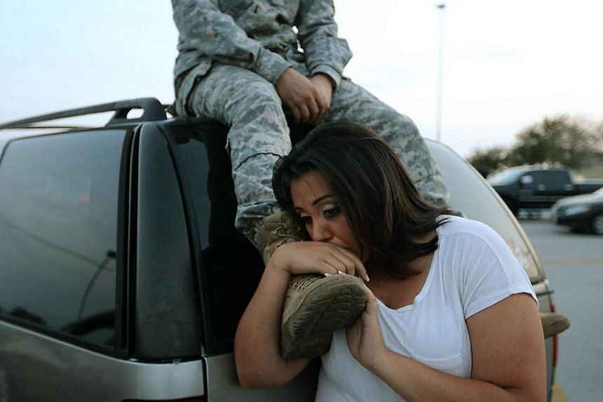 A soldier and his wife waiting to get back to their home on the base at Fort Hood, Texas, on April 2, 2014. -- PHOTO: REUTERS