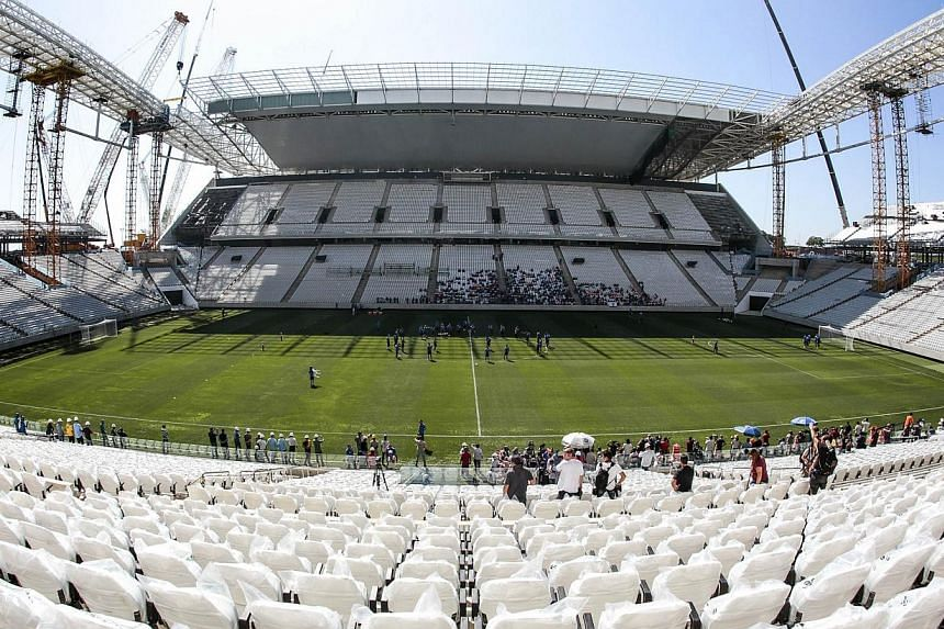 The Corinthians Arena - which is due to hold the opening match of the Brazil 2014 Fifa World Cup between Brazil and Croatia on June 12 - could be closed in places if it is not made safer for fans. -- PHOTO: AFP