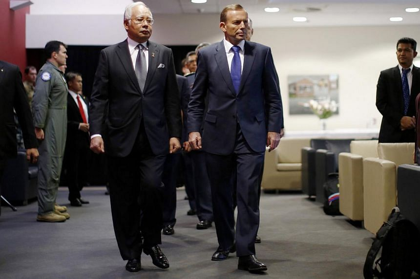 Malaysia's Prime Minister Najib Razak (left) and Australia's Prime Minister Tony Abbott arriving at a briefing on the search for Malaysia Airlines flight MH370 at RAAF Base Pearce near Perth on April 3, 2014. -- PHOTO: REUTERS