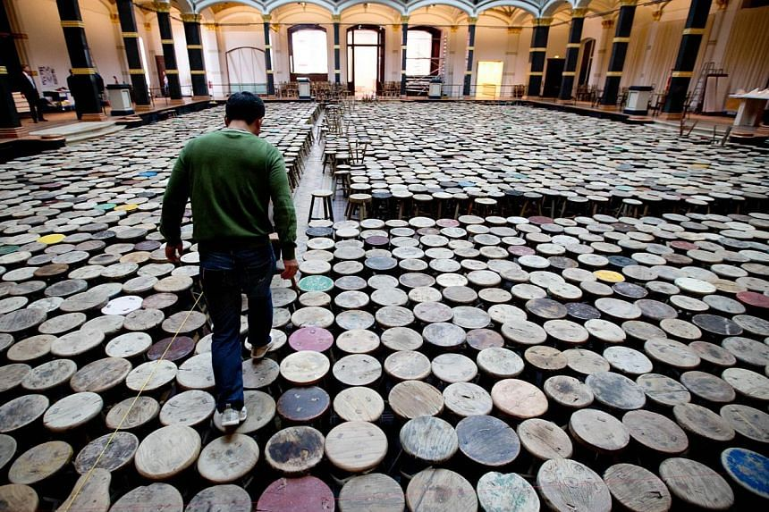 Stools, an installation by Ai, features 6,000 wooden stools gathered from Chinese villages from past centuries, painted green, red and yellow. It presents a sea of uniformity and yet each is unique, to reflect the tension of modernisation and t
