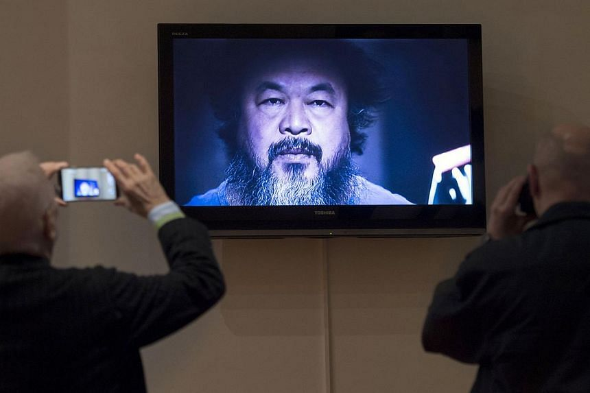 The heavy metal music video Dumbass by Ai Weiwei plays at an exhibition by the dissident Chinese artist at Berlin's Martin Gropius Bau museum, said to be his biggest solo show ever. The exhibition, held in 18 rooms and the Lichthof court, displ