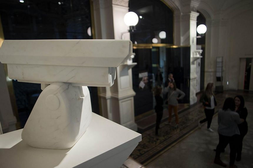 "Ai's trademark wit is also on display, with marble ""surveillance cameras"" hanging at the museum entrance in the sculpture entitled Surveillance Camera. -- PHOTO: AFP"