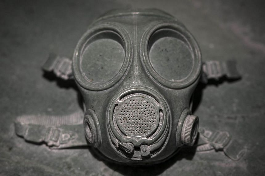 Mask is a marble mask atop a tombstone, alluding to China's problems with smog. -- FILE PHOTO: AFP