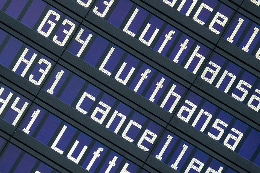 """Cancelled flights of German airline Lufthansa are displayed on a board at the """"Franz Josef Strauss"""" airport in Munich, southern Germany, on April 3, 2014. German airline Lufthansa, which is currently battling the biggest strike in its history, expect"""