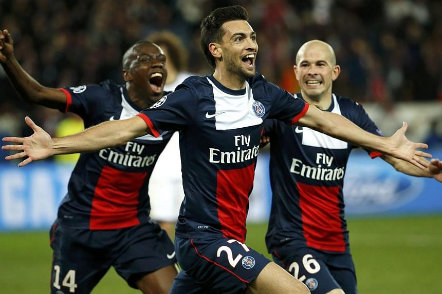 Paris St Germain's Javier Pastore (centre) celebrates with team mates after scoring the third goal for the team during their Champions League quarter-final first leg soccer match against Chelsea at the Parc des Princes Stadium in Paris on April 2, 20