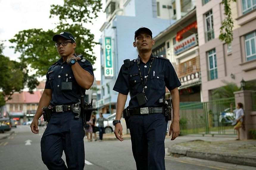 Police officers from Geylang Neighbourhood Police Centre patrolling the streets of Geylang Lorong 8 to 14 in the evening of March 3, 2014.  -- ST FILE PHOTO: KUA CHEE SIONG