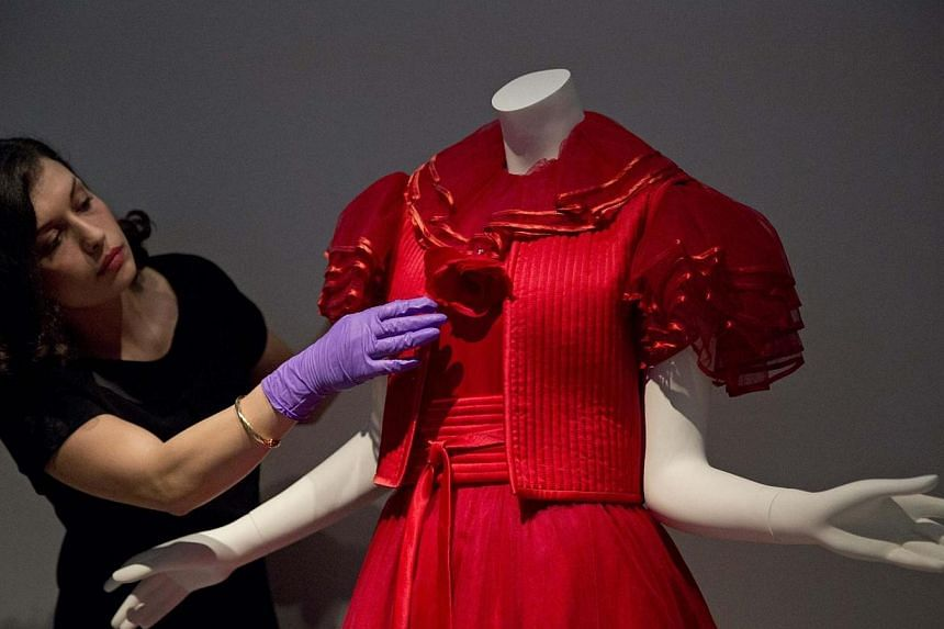 A red tulle evening dress by Valentino, 1977, The exhibition includes some 120 ensembles and accessories by fashion houses including Dolce & Gabbana, Giorgio Armani, Fendi, Ginafranco Ferre, Gucci, Missoni, Prada, Pucci and Versace. -- PHOTO