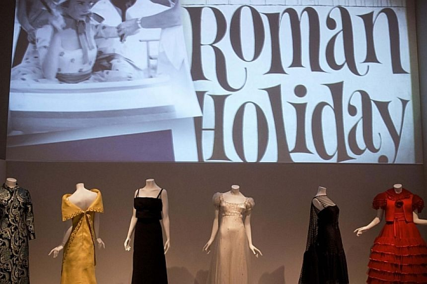 The exhibition shows dresses worn by actresses such as Audrey Hepburn in films such as Roman Holiday (1953). -- PHOTO: REUTERS