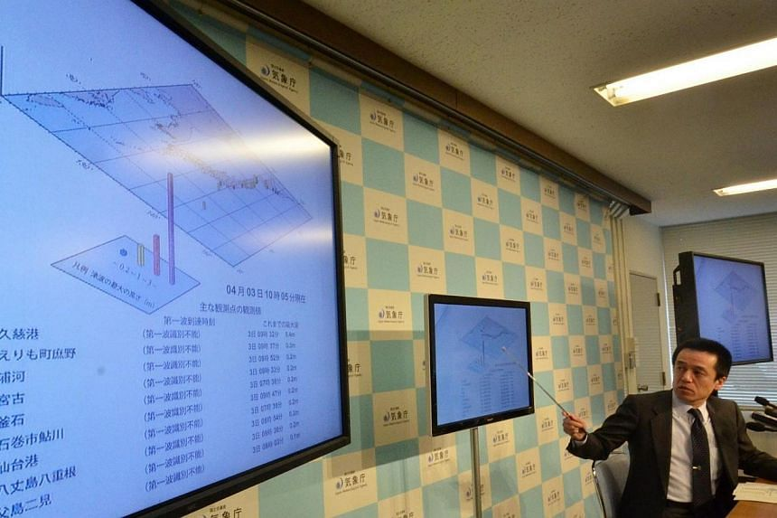 Japan Meteorological Agency officer Yohei Hsegawa speaks about a tsunami at a press conference at the agency in Tokyo on Aug 3, 2014.Small tsunami waves hit northern Japan early on Thursday, April 3, 2014, following a powerful 8.2-magnitu