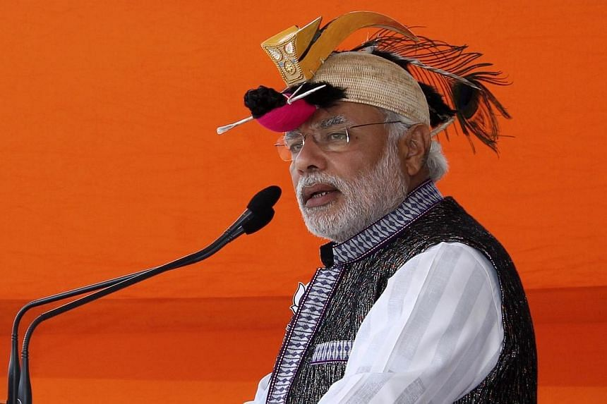 Hindu nationalist Narendra Modi, prime ministerial candidate for main opposition Bharatiya Janata Party (BJP) and Gujarat's chief minister, addresses his supporters during a rally ahead of the general election in Itanagar in the northeastern Indian s