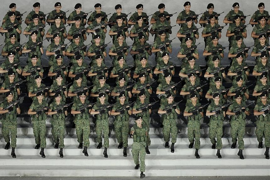 """Soldiers marching down the steps of the Marina Bay Floating Platform during the National Day Parade (NDP) at Marina Bay Floating Platform on Aug 9, 2011.The Ministry of Defence will be looking at a """"more systematic"""" way to share the experiences"""