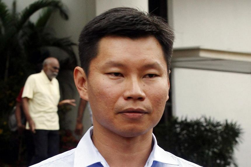 National Parks Board (NParks) assistant director Bernard Lim Yong Soon leaving the State Courts on March 26, 2014.Lim has been ordered by a district court to give his defence, after it found enough evidence against him to continue with the tria