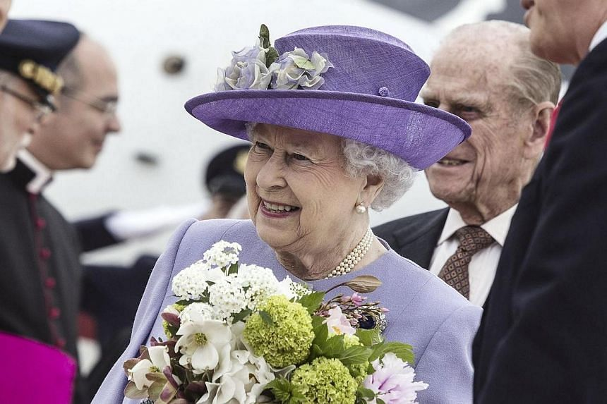 Britain's Queen Elizabeth II arrives at Ciampino Airport in Rome on Thursday, April 3, 2014. Queen Elizabeth II and her husband Prince Philip arrived in the Vatican on Thursday for their first meeting with Pope Francis on a one-day visit to Rome