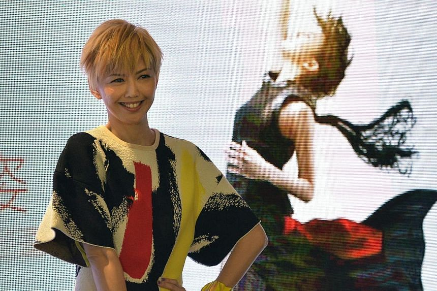 With a spunky blonde haircut, a colourful graphic print outfit and a radiant smile, Mandopop queen Stefanie Sun was clearly happy to be back in Singapore.-- ST PHOTO: DESMOND FOO