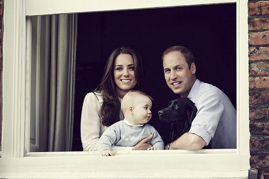 In a handout picture released by Kensington Palace and Camera Press on March 29, 2014 Britain's Prince William, Duke of Cambridge (right) and Britain's Catherine, Duchess of Cambridge (left) pose with their son Prince George of Cambridge (centre) and
