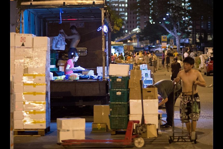 Wholesalers operate from lorries, and the vegetables are mostly displayed in crates or boxes. Restaurant owners and wet market vendors frequent the place. -- ST PHOTOS: LIM SIN THAI