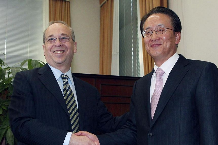 United States Assistant Secretary of State for East Asian and Pacific Affairs Daniel Russel (left) with his South Korean counterpart Lee Kyung Soo during their meeting in Seoul on Jan 26, 2014. Mr Russell has cautioned China not to use force to pursu