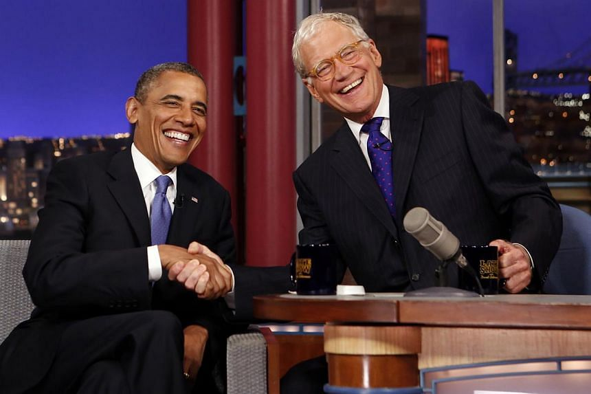 Seated with talk show host David Letterman, United States President Barack Obama makes an appearance on the Late Show with David Letterman at the Ed Sullivan Theater in New York City on Sept 18, 2012. -- FILE PHOTO: REUTERS