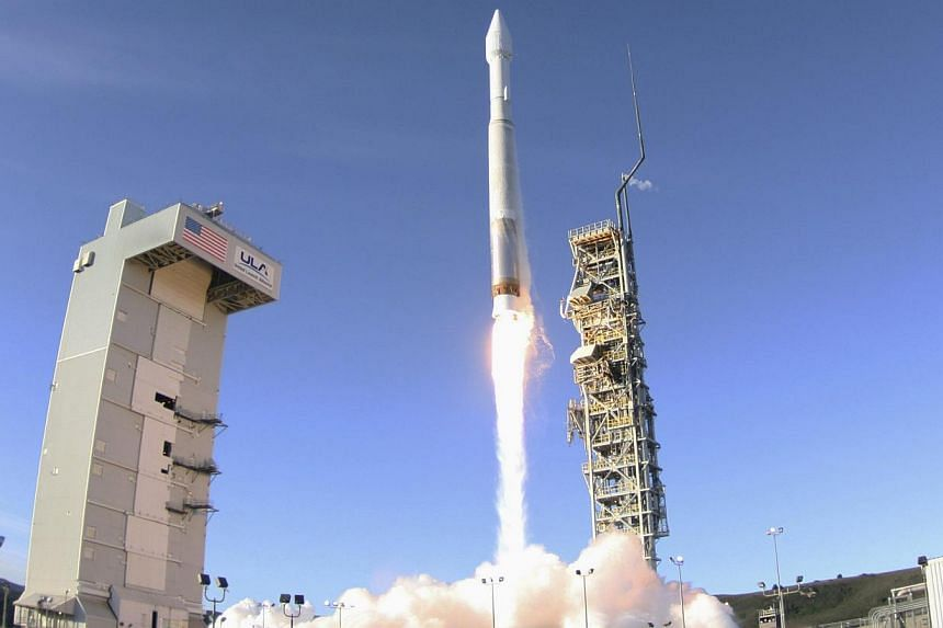 A rocket carrying a satellite for the Defence Meteorological Satellite Programme is launched from Vandenberg Air Force Base in California on April 3, 2014. -- PHOTO: REUTERS