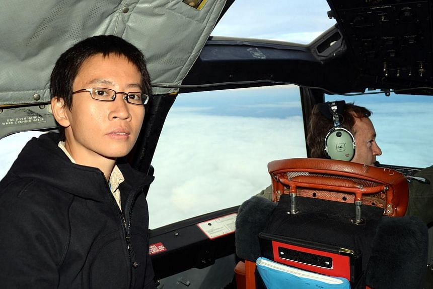 Thailand correspondent Tan Hui Yee in the cockpit of the Royal New Zealand Air Force P3K3 Orion as it flies over the Indian Ocean in search of Malaysia Airlines flight MH370 on March 31, 2014. -- ST PHOTO: TAN HUI YEE