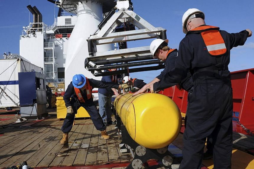 An autonomous underwater vehicle is hoisted back on board the Australian Defence vessel Ocean Shield after a successful buoyancy test in the southern Indian Ocean as part of the continuing search for the missing Malaysian Airlines flight MH370 on Apr
