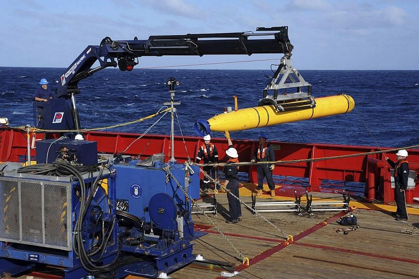 The Bluefin 21, the Artemis autonomous underwater vehicle (AUV), is hoisted back on board the Australian Defence Vessel Ocean Shield after a successful buoyancy test in the southern Indian Ocean as part of the continuing search for the missing Malays