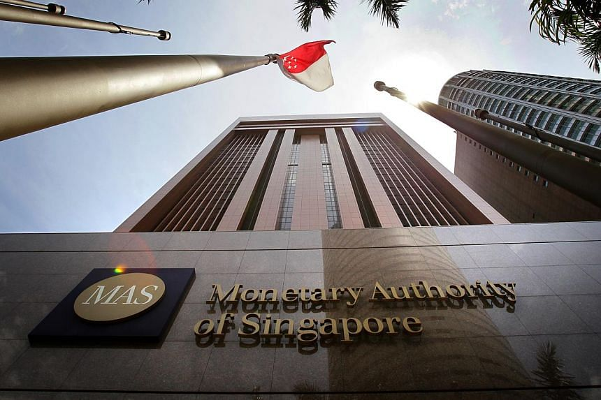 Singapore's central bank is expected to stick with a tight monetary policy stance to guard against inflationary pressures, while the economy probably maintained a solid pace of year-on-year growth in the first quarter. -- ST FILE PHOTO: KEVIN LIM&nbs
