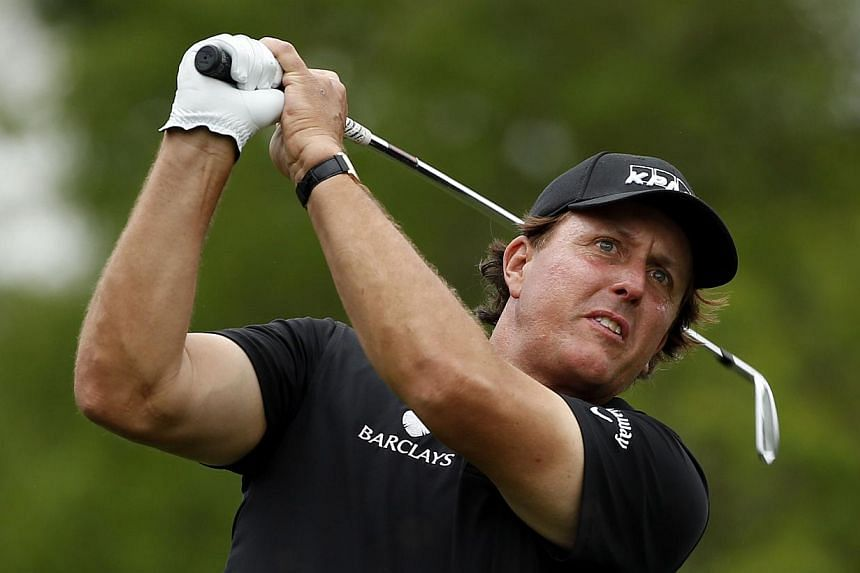 Phil Mickelson of the United States watches his tee shot on the ninth hole during round one of the Shell Houston Open at the Golf Club of Houston on April 3, 2014 in Humble, Texas. -- PHOTO: AFP