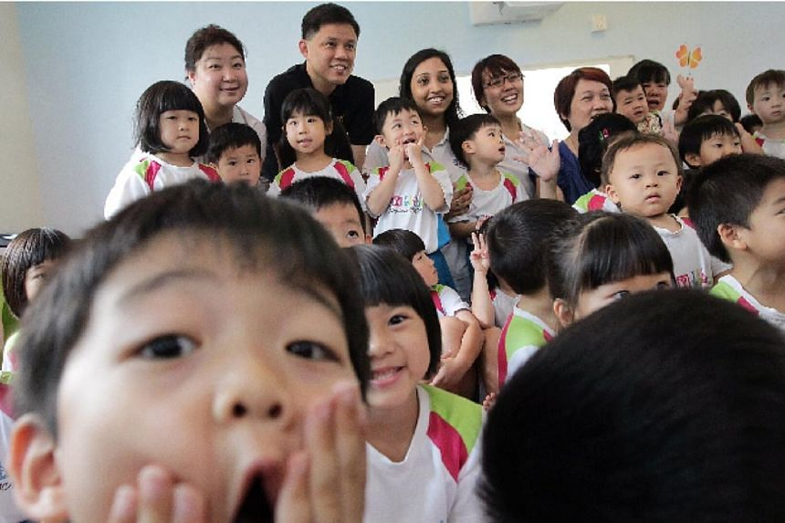 Minister for Social and Family Development Chan Chun Sing (in black) poses for a group photograph with children and teachers from MY World @ Simei. -- PHOTO: NEO XIAOBIN
