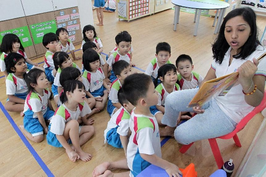 A teacher from MY World @ Simei reads a storybook out to the children at the centre. -- PHOTO: NEO XIAOBIN