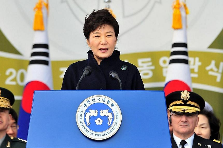 South Korean President Park Geun Hye (centre) speaks during the joint commission ceremony of 5,860 new military officers of the army, navy, air force and marines at the military headquarters in Gyeryong, south of Seoul, on March 6, 2014. -- FILE PHOT