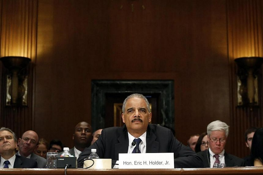 US Attorney General Eric Holder testifies about his FY2015 budget request at a Senate Appropriations Committee hearing on Capitol Hill in Washington on April 3, 2014. -- PHOTO: REUTERS