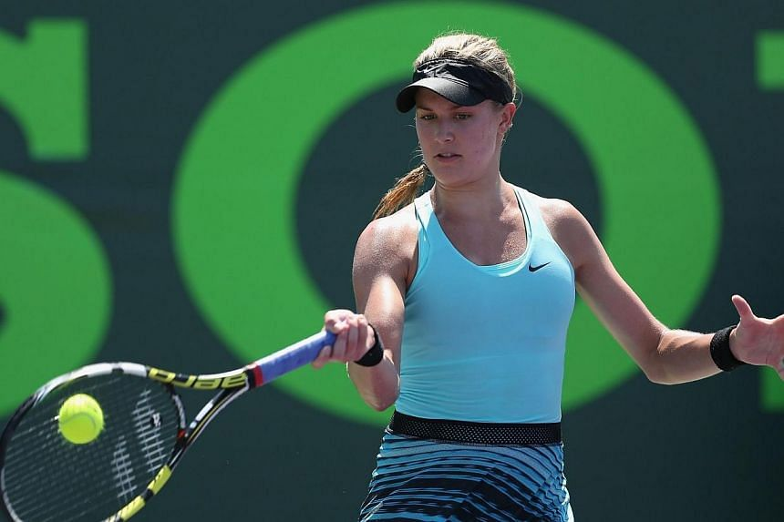 Eugenie Bouchard of Canada plays a forehand against Elina Svitolina of Ukraine during their second round match during day 5 at the Sony Open at Crandon Park Tennis Center on March 21, 2014, in Key Biscayne, Florida. Bouchard held off former world No.