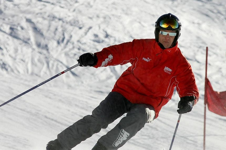 """A picture taken on Jan 14, 2005 shows German Fourmula 1 driver Michael Schumacher skiing during a slalom race in the winter resort of Madonna di Campiglio, in the Dolomites area, northern Italy.Michael Schumacher has """"moments of consciousness a"""