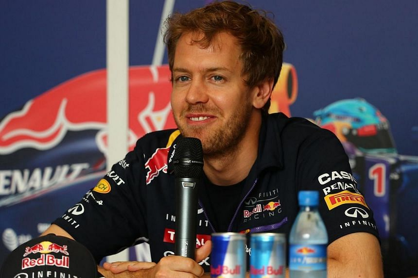 Formela One driver Sebastian Vettel of Infiniti Red Bull Racing speaks during a press conference on Thursday, April 3, 2014, at the Sakhir circuit in Manama ahead of the Bahrain Formula One Grand Prix. Vettel admitted on Thursday that he was braced f