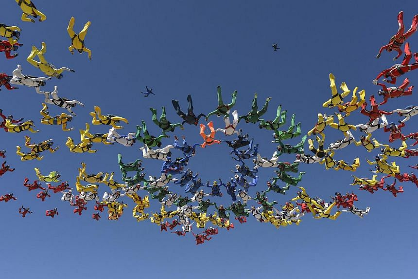 Skydivers form a missing man formation in Eloy, Arizona on April 3, 2014. -- FILE PHOTO: REUTERS