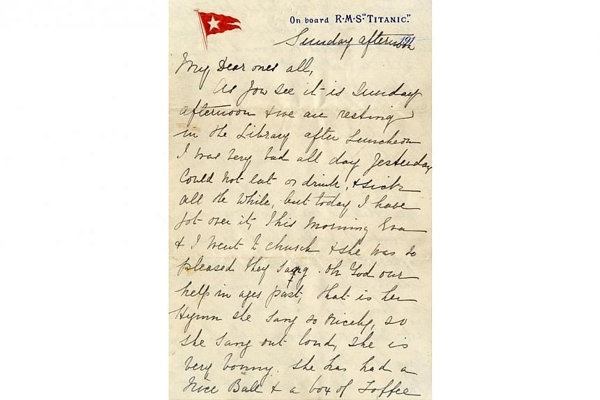 An undated handout reproduction of a letter released by Henry Aldridge and Son on April 1, 2014 shows a page of the only known letter to have been written on board the Titanic on the day the liner struck an iceberg and sank. -- PHOTO: AFP/HENRY ALDRI