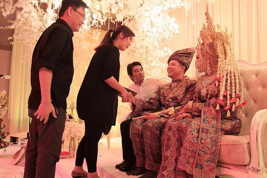 Hype Records director Ken Lim (third from left) congratulates the couple on stage. -- ST PHOTO: NEO XIAOBIN